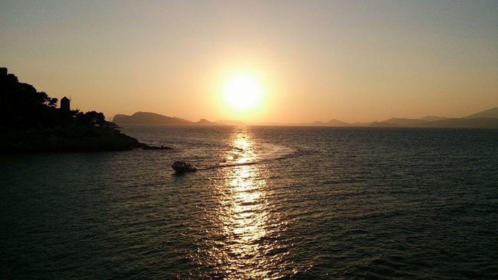 Sunset on Hydra 🌅 Whereisthesummer Supportforgreece Sunset Greece Greekislands Hydra Boat Windmill Summer2015 Sun Sky Sea Aegansea Sonyxperiaz Shot VSCO Vscocam