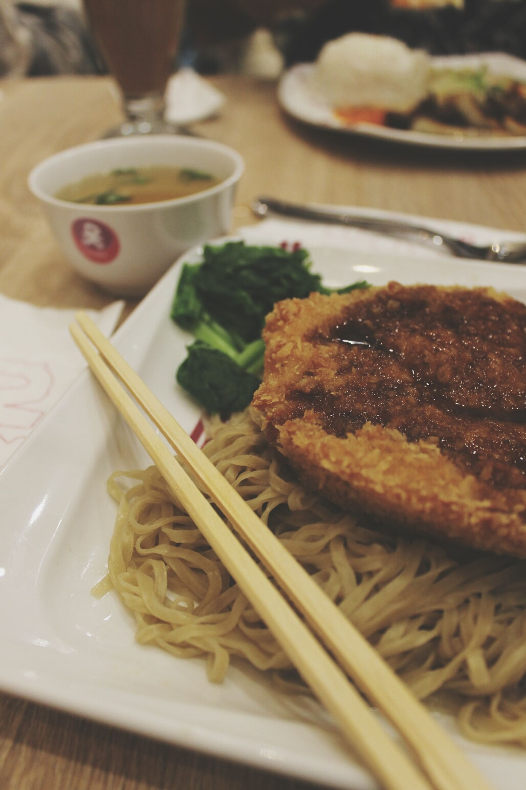 food and drink, food, ready-to-eat, plate, chopsticks, serving size, indoors, freshness, noodles, close-up, table, meal, bowl, healthy eating, vegetable, meat, no people, indulgence, day