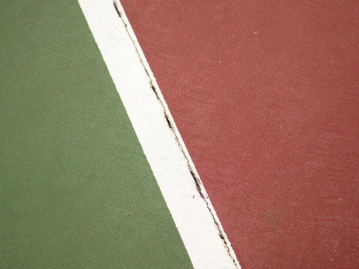 On the line Backgrounds Close-up Competition Court Day Green Color Minimalism Multi Colored No People Outdoors Red Single Line Sport Synthetic Tennis Tennis Court Yard Line - Sport