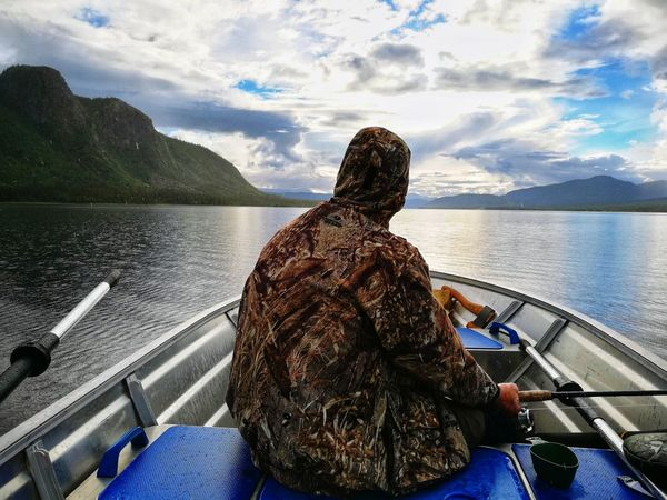 Water Rear View Nautical Vessel Lake One Person Sitting Mode Of Transport Transportation Cloud - Sky Outdoors One Man Only Nature Mountain Fishing Boat Fishing Fishing Trip Fishing Rod Fishing Man Fisherman Fisherman Boat