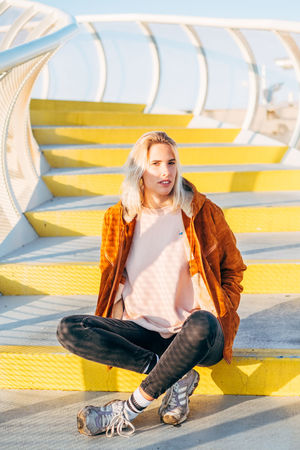 Sevilla / Spain EyeEmNewHere Metropol Parasol SPAIN Sevilla The Graphic City Blond Hair Casual Clothing Day Front View Full Length Happiness Leisure Activity Lifestyles Looking At Camera One Person Outdoors People Plaza De España Portrait Real People Sitting Smiling Young Adult Young Women