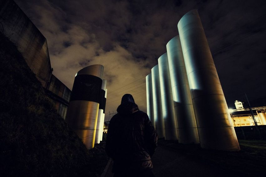 Dark Industrial Industry Low Angle View Rear View Adult Building Exterior Built Structure Cloud - Sky Flue Hood Industrial Area Night One Person Outdoors Real People Sky Standing Streetphotography Urban
