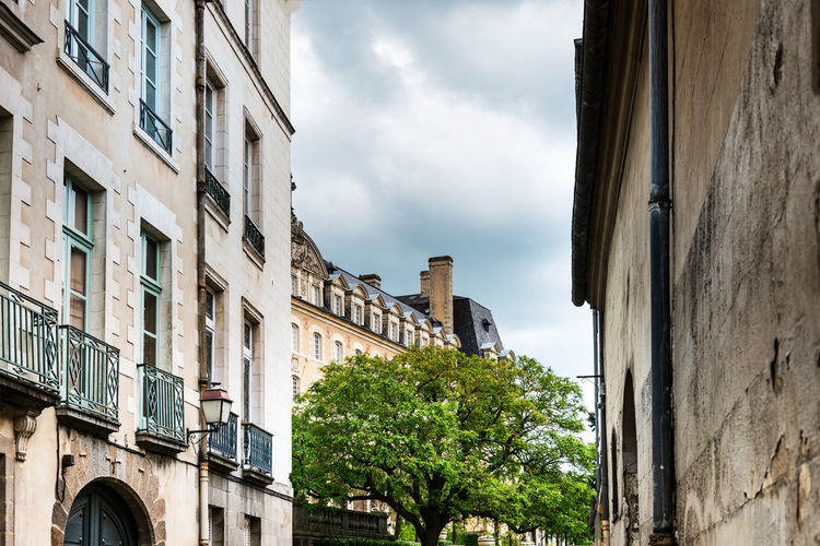 Apartment Architecture Building Building Exterior Built Structure City Cloud - Sky Day Growth History Low Angle View Nature No People Old Outdoors Plant Residential District Sky The Past Tree Window