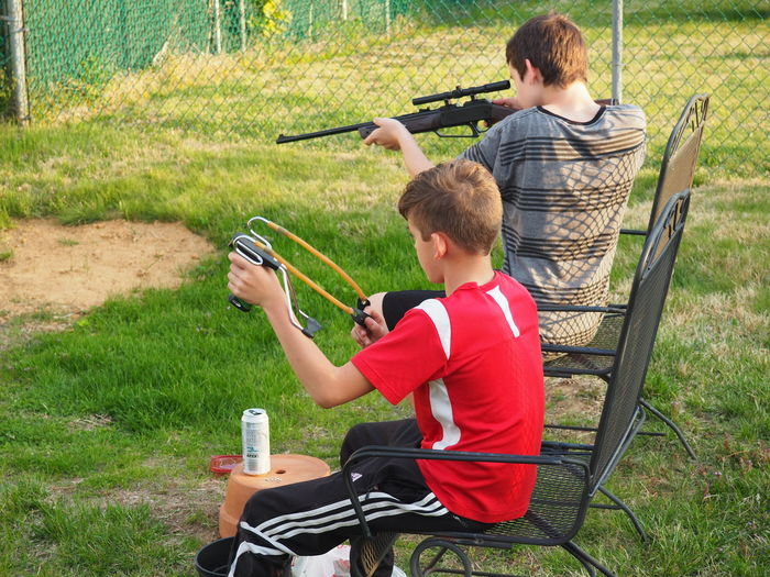 Bb Gun Better Than Video Games Boys Childhood Fun Grass Leisure Activity Lifestyles Outdoors Playing Slingshot Target Target Practice Target Shooting Targets Youth Sports Target Shooting A Weapon Aiming Rifle Pistol Gun Slide - Play Equipment Children Single Parent Single Father Son