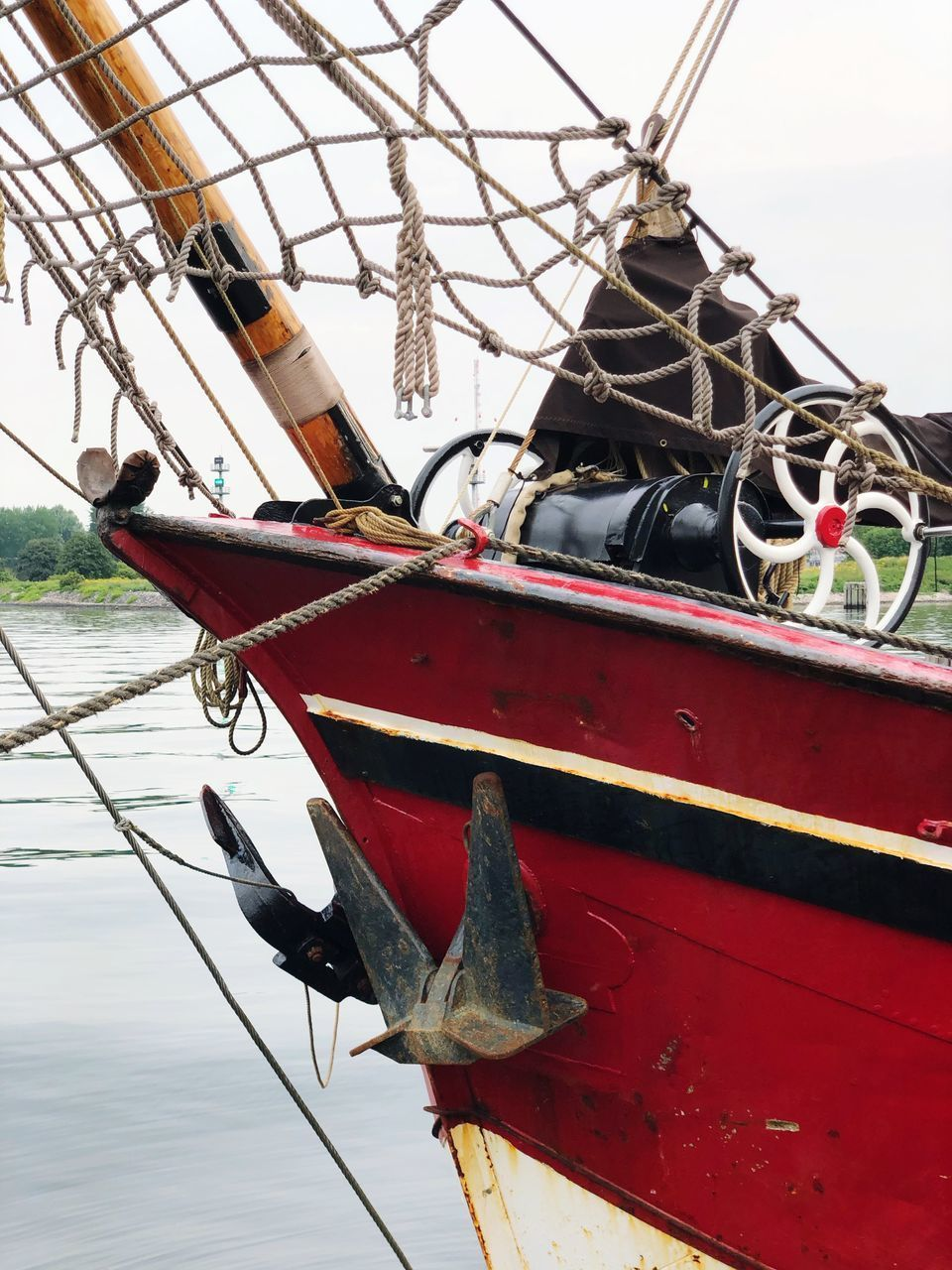mode of transportation, nautical vessel, transportation, day, nature, water, no people, moored, sky, outdoors, metal, focus on foreground, rope, ship, close-up, red, wood - material, travel, lake, fishing boat, fishing industry