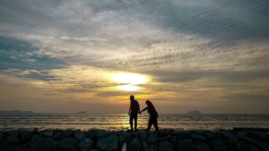 Till the end of time EyeEm Best Shots EyeEmNewHere Couple Couple - Relationship Sea Sunset Beach Water Silhouette Sun Friendship Standing Shore Calm Coastline