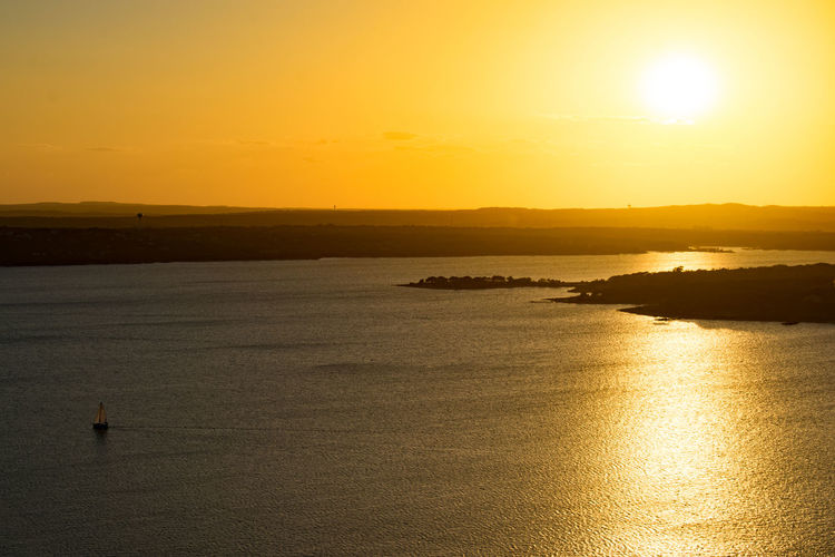 Photos taken from the Oasis Restaurant at Lake Travis, in Austin, Texas, at sunset. Beauty In Nature Day Horizon Over Water Idyllic Lake Lake View Landscape Nature Outdoors Reflection Scenics Sea Silhouette Sky Sun Sunlight Sunset Tranquil Scene Tranquility Water Waterfront