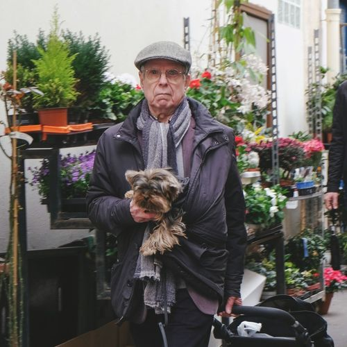 Shopping with dog Market One Animal Mammal Domestic Animals Pets Domestic One Person Real People Lifestyles Adult Front View Mature Men Leisure Activity Warm Clothing