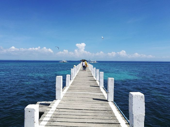 Sea Pier Full Length Horizon Over Water The Way Forward Beach Jetty Outdoors Day Vacations Sky Beauty In Nature Summer Clear Sky People Adult Scenics Adults Only Nature Water Eyeem Philippines