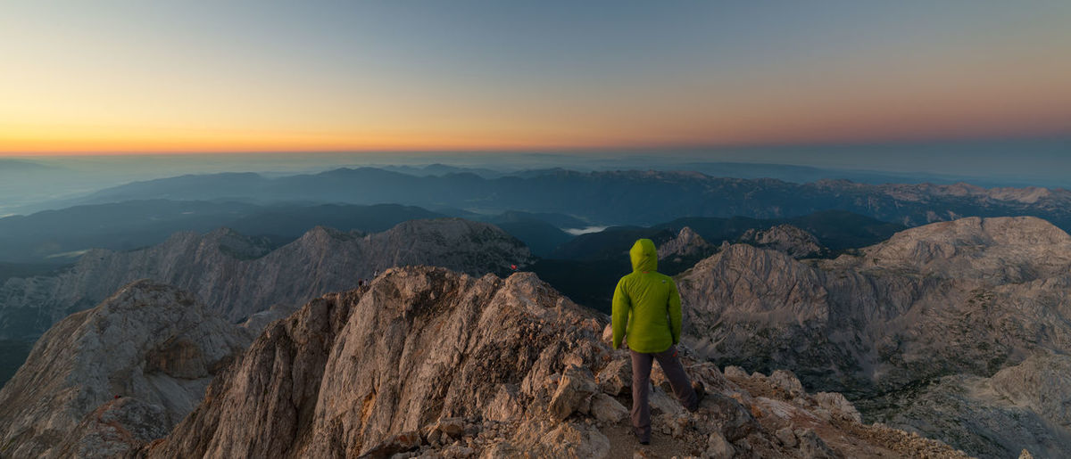 Sunrise on the top of the highest peak in Slovenia, Triglav Adventure Beauty In Nature Dawn Hiking Horizon Idyllic Landscape Morning Mountain Mountain Range Nature Outdoors Panoramic Person Photography Remote Rock Rock Formation Scenics Slovenia Summer Sunrise