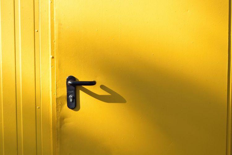 EyeEm Selects Yellow Convenience Door Doorknob Close-up Door Handle Front Door Closed Door Entryway Closed Keyhole