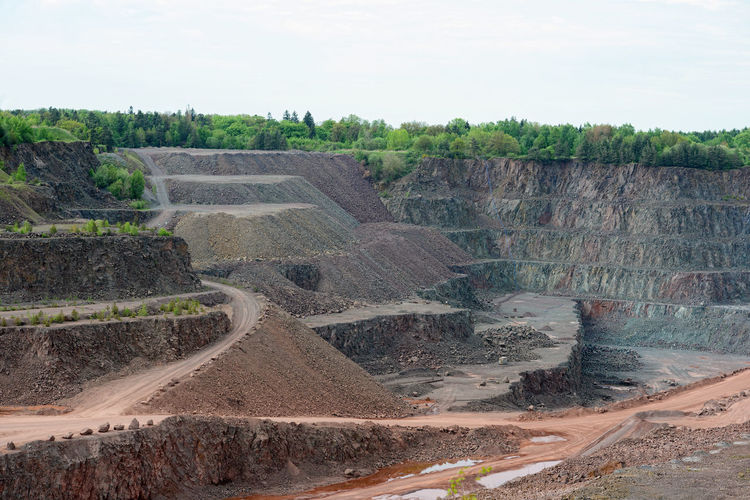 aerial view over a quarry hole. mining industry. Mine Minerals Mining Quarry Quarry Rock Stonepit Rocks Steinbruch Construction Material Construction Materials Production Stone Pit Transportation Surface Mine