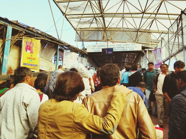 Two friends at indian railway station Large Group Of People Person Crowd Walking Travel Destinations Non-western Script Casual Clothing Passenger Tourism City Life Retail  Customer  Buying Small Business Men Market Lifestyles City Market Stall People And Places