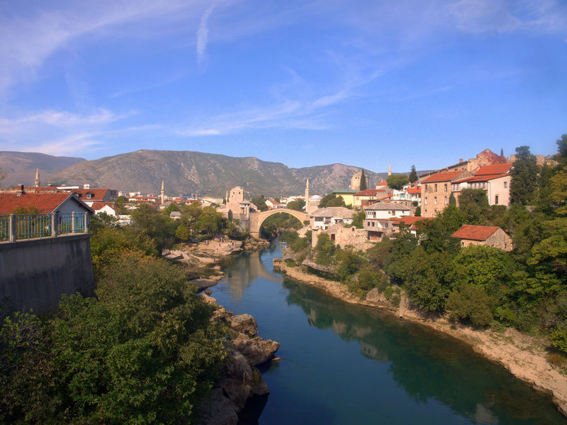 The bridge in mostar as seen from the other bridge Bosnia And Herzegovina Mostar Mostar Bosnia Mostar Bridge Arch Architecture Beauty In Nature Bosnia Bridge Bridge - Man Made Structure Building Exterior Built Structure Day Mountain Nature No People Outdoors Reflection River Scenics Sky Tranquility Travel Destinations Tree Water