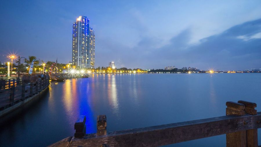 the bridge, pier and lights in the Ancol beach Jakarta Highrise Portfolio Of Arif Wibowo Photograph By Jgawibowo Portfolio Of Jgawibowo Photography By Jgawibowo Twilight Reflection Landscape Beach Bridge Tourist Attraction  Tourist Destination City Cityscape Urban Skyline Illuminated Water Skyscraper Nightlife Light Trail