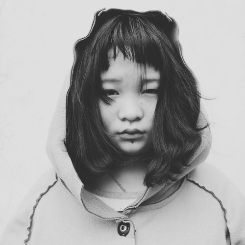Close-Up Of Girl In Hood Against White Background
