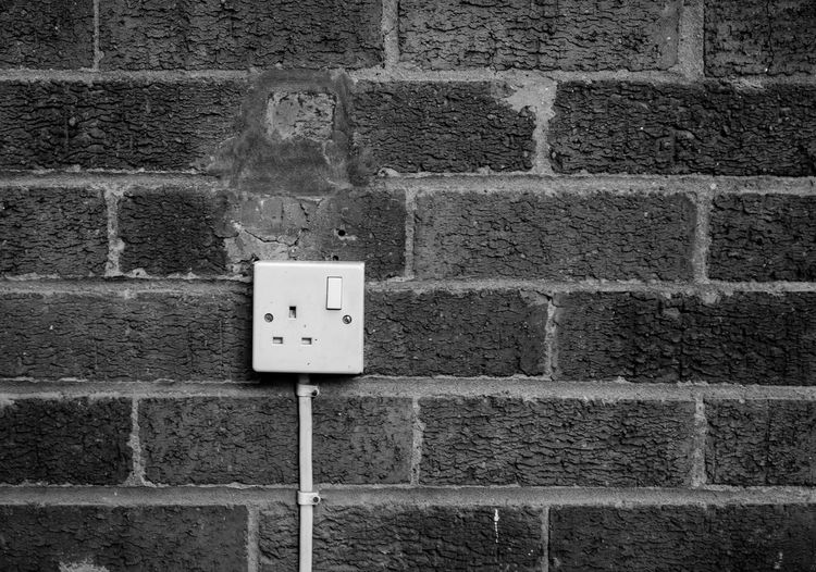Close-up of electric socket on wall