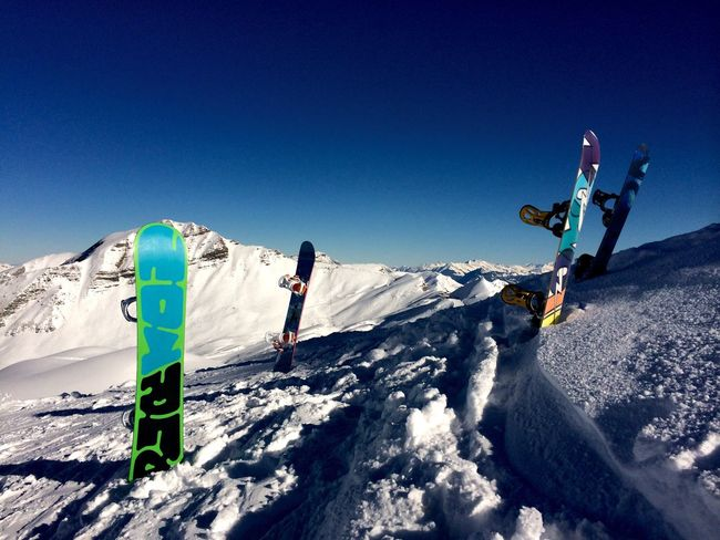 Our Snowboard s placed in the Snow on the Mountain in Meribel . Snowboarding Blue Sky Snow Sports