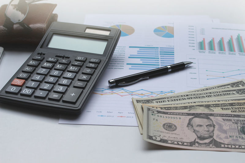 Budget Business Calculator Close-up Corporate Business Counting Currency Day Finance Financial Figures High Angle View Indoors  No People Occupation Paper Paper Currency Technology