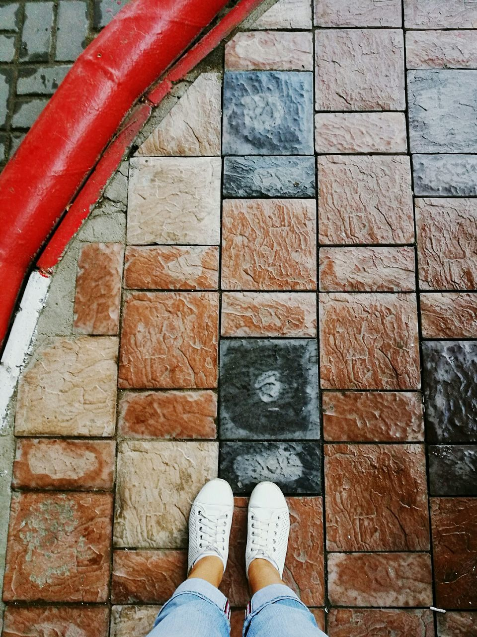 low section, real people, shoe, human body part, body part, one person, standing, human leg, personal perspective, lifestyles, leisure activity, high angle view, directly above, architecture, unrecognizable person, flooring, human foot, built structure, day, tiled floor, paving stone, human limb
