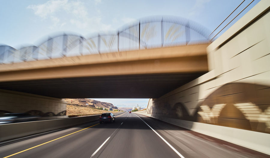 Transportation Road Architecture Built Structure Bridge Bridge - Man Made Structure Motion Connection Mode Of Transportation Symbol Road Marking Motor Vehicle Direction Marking Land Vehicle on the move Car The Way Forward Travel Nature No People Outdoors Road Trip