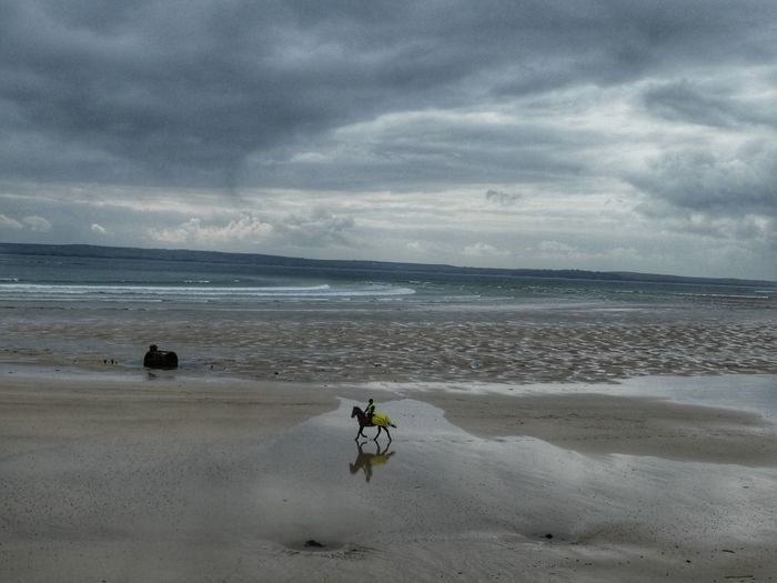 Reflection on Gress Beach Unrecognizable Person Outdoor Photography VisitScotland Horse On Beach Beach moments of happiness Moment Beach Sky Cloud - Sky Water Sea Land Sand Nature Horizon Horizon Over Water Beauty In Nature Scenics - Nature Overcast Tranquility Transportation Motion One Person Tranquil Scene Outdoors