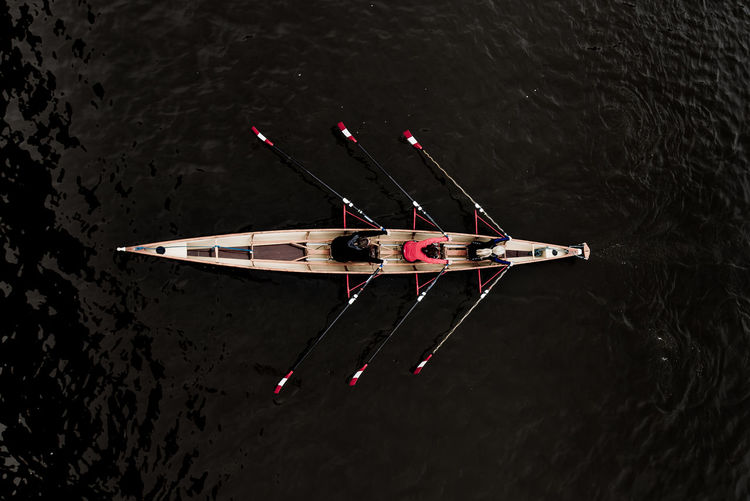High Angle View Of People Rowing In Boat On Lake
