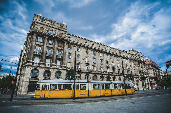 City Architecture Cloud - Sky Transportation Building Exterior Tourism Tram Yellowtram Streetphotography Tram And Bus Buildings & Sky Clock Tower No People Budapest Budapest, Hungary