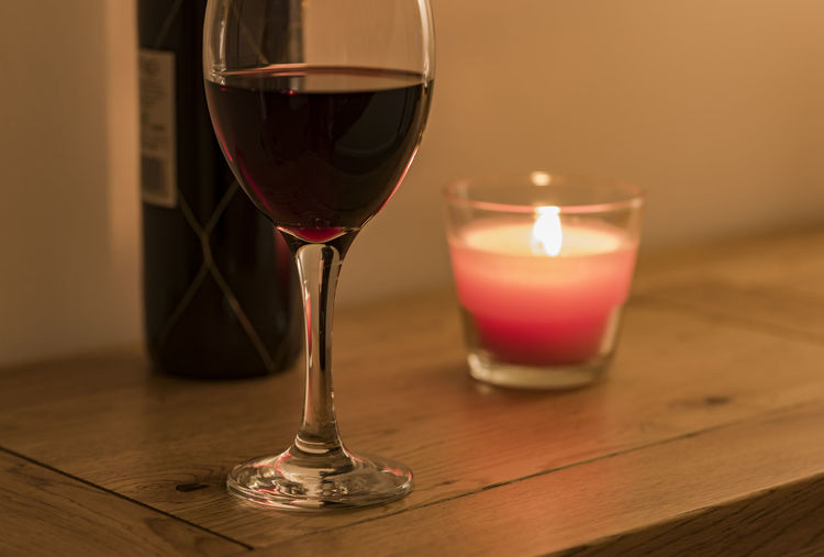 After Work Celebration Food And Drink Home Me Time Peace Unwind Alcohol Burning Candle Cosy Drink Festive Flame Illuminated Luxury Magazine No People Red Wine Relax Solid Oak Table Warm Wine Wineglass