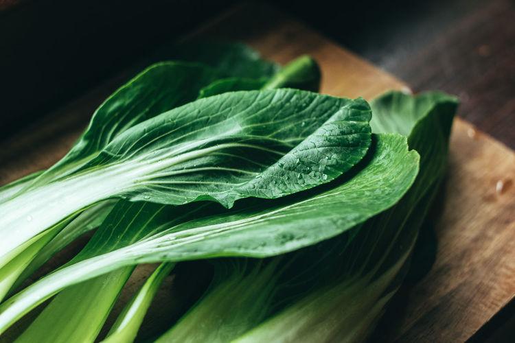 Close-up of fresh green leaf on cutting board