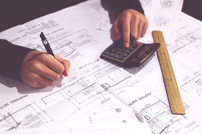 Paper Blueprint Plan Human Hand Writing Human Body Part Diagram ARCHITECT Finance Architecture Calculator Paperwork Working Men One Man Only Financial Figures Graph Occupation Stock Market And Exchange Indoors