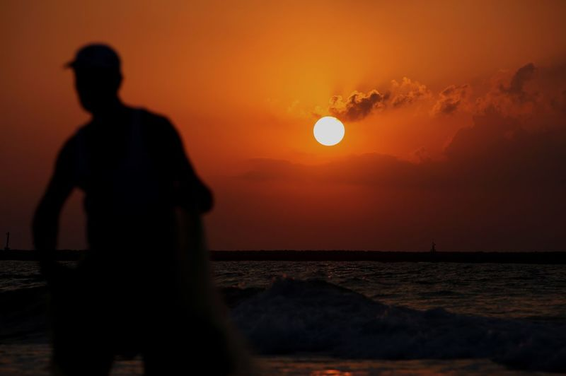 Fisherman Sunset Sky Silhouette Orange Color Beauty In Nature Sea Real People Scenics - Nature Water Horizon Over Water Sun Leisure Activity Nature Beach Men Land Tranquility People Lifestyles Outdoors