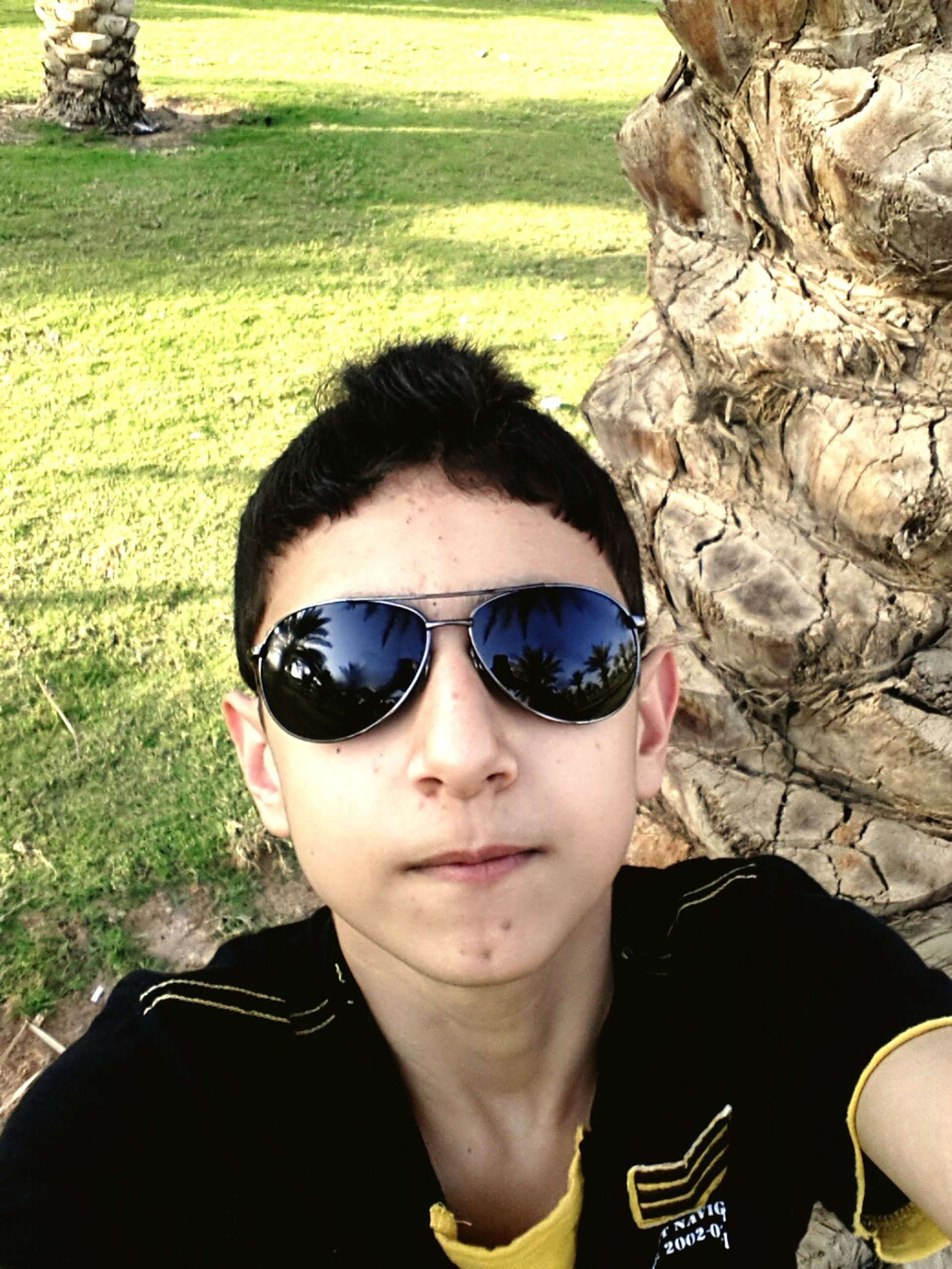 portrait, looking at camera, sunglasses, headshot, lifestyles, person, front view, young men, young adult, leisure activity, close-up, smiling, head and shoulders, mid adult men, focus on foreground, human face, day, handsome
