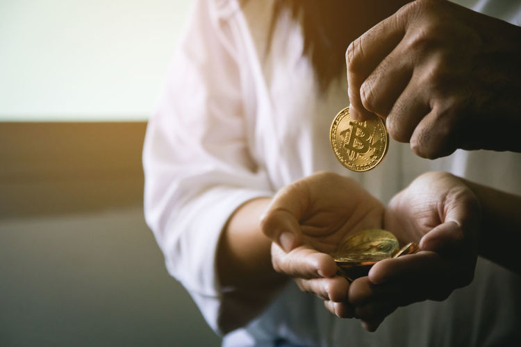 Bitcoin Bitcoin Mining Close-up Coin Currency Day Exchange Finance Gold Gold Colored Holding Human Body Part Human Hand Indoors  Midsection One Person People Savings Trade Wealth