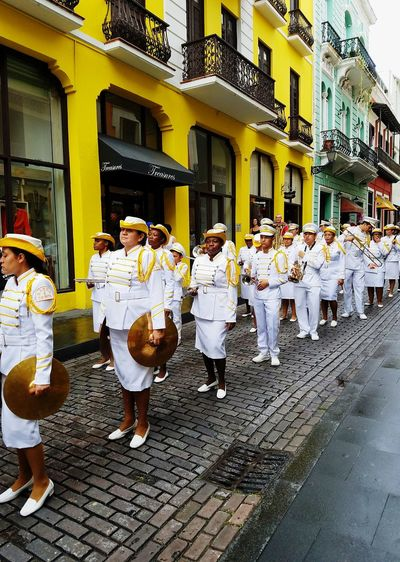 Street Outdoors People Architecture Lifestyles Real People Splash Of Colour Yellow Perspective Band Streetphotography waiting game White Uniform Take Over Music Open Edit White Album Formation Playing Music Performance EyeEm Diversity The Street Photographer - 2017 EyeEm Awards Paint The Town Yellow