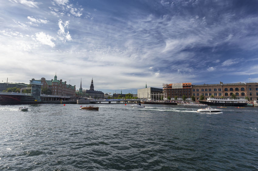 Wide angle view of summer activities on a canal in Copenhagen, Denmark. Architecture Denmark Scandinavia Statue Swimming Tourist Attraction Canal Church Of Our Saviour Copenhagen Danish Destination Historical History Landscape Nyhavn Outdoors Red Fort Relax Rundetaarn Spire  Summer Swim Tourism Traditional