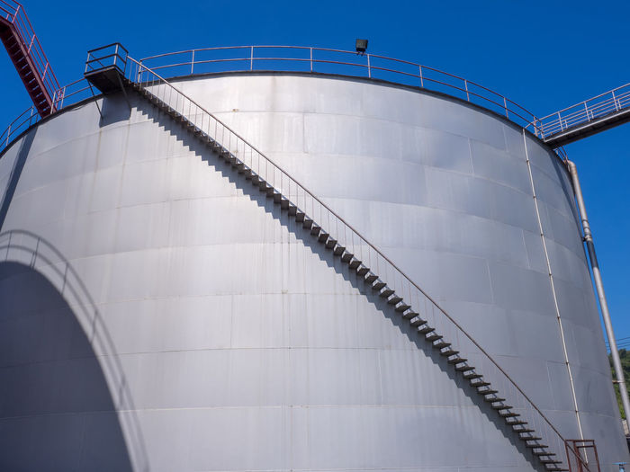 Low angle view of storage tank against clear sky
