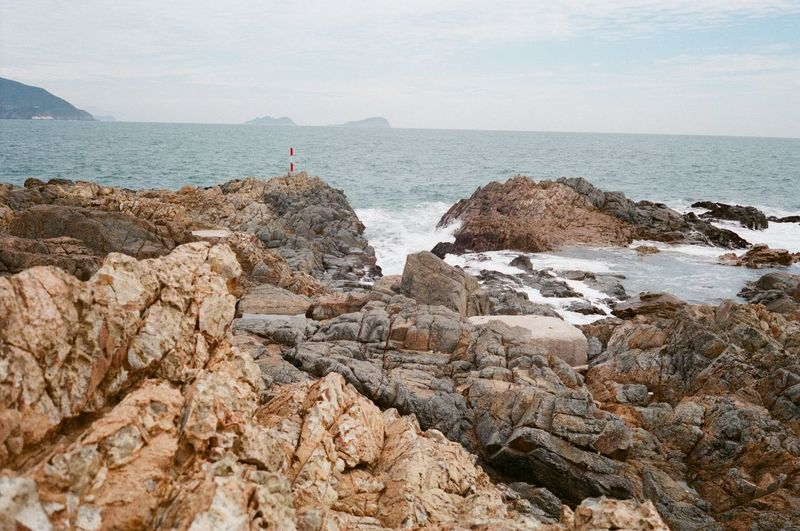 Nature Day No People Sea Rock Water Rock - Object Solid Horizon Sky Beach Horizon Over Water Scenics - Nature Land Rock Formation Beauty In Nature Tranquility Tranquil Scene Architecture Rocky Coastline