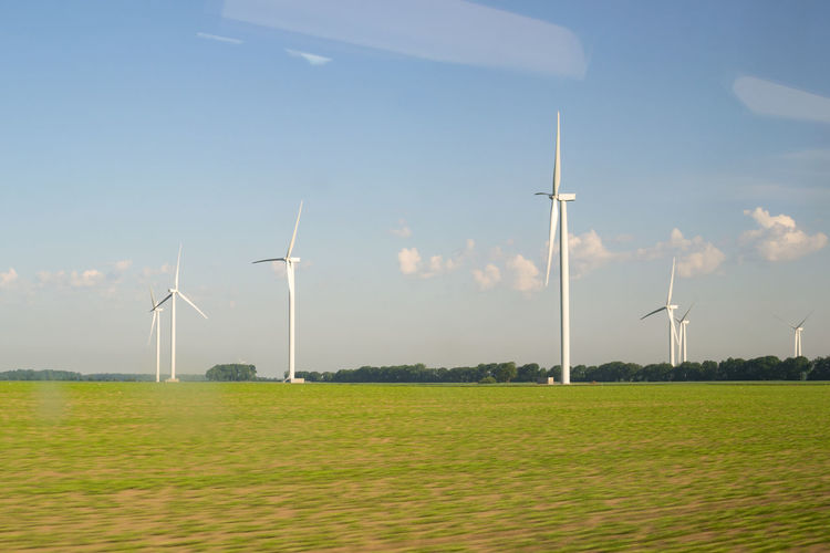 Agriculture Alternative Energy Day Environmental Conservation Field From A Train Window Fuel And Power Generation Innovation Landscape Nature No People Outdoors Renewable Energy Rural Scene Sky Sustainability Sweden Train Journey Traveling Wind Power Wind Turbine