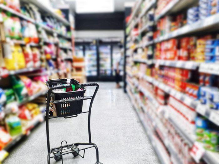 Blur image people shopping in supermarket, Close up shopping cart with product in basket, Urban life concept Supermarket Groceries Shopping Cart Food Staple Consumerism Shelf Store Customer  Choice Retail  Produce Aisle Market Stall Shopping Basket For Sale Market Refrigerated Section Stall Retail Place Street Market Choosing Farmer Market Commercial Activity
