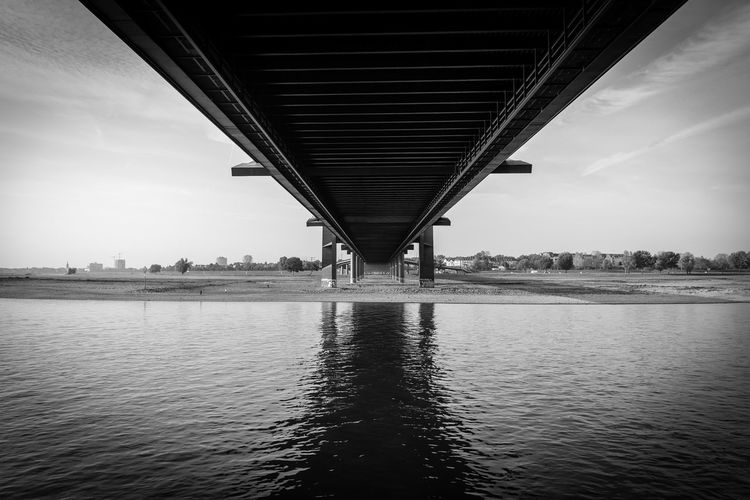 Under The Bridge Sky Day Built Structure Architecture Outdoors A New Perspective On Life Holiday Moments Deutschland Germany Europe Urban Urban Skyline Düsseldorf City City Life Water Bridge Bridge - Man Made Structure River No People Low Angle View Underneath Long Monochrome Blackandwhite