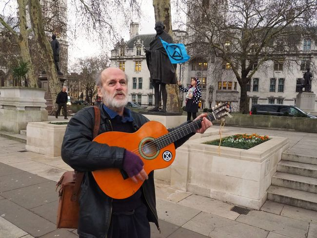 London Earth Strike // Climate Protest // Parliament green 15/01/2019 Extinction Rebellion LONDON❤ Save Our Future Green Protest Climate Change Protest Environment Protest Earth Strike Protesters Protest Stevesevilempire London News Steve Merrick Olympus OM-D Music Musical Instrument Guitar String Instrument Men Real People Playing