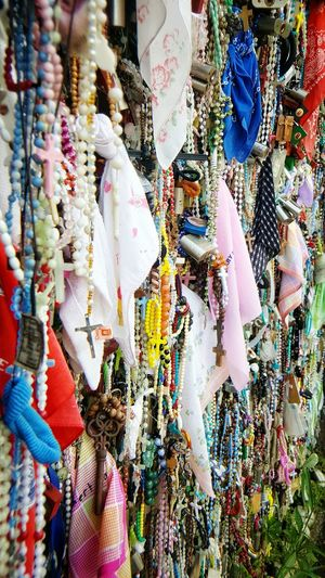 Colorful rosaries for sale at market stall