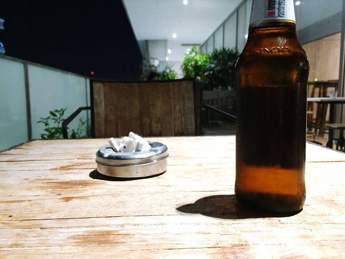 Bottle of beer Sincha One Shot Drink Up Cold Beer On Round Table Thai Beer  Beer Bottle