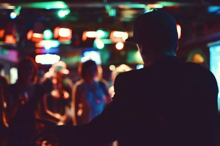 Casual Clothing City Life Defocused Focus On Foreground Illuminated Leisure Activity Lifestyles Light Night Selective Focus