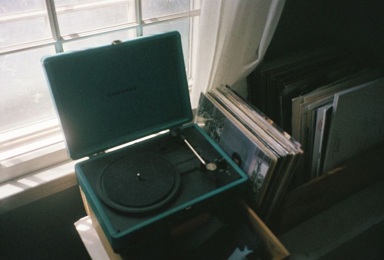 Vinyl Records Record Player 35mm Film 35mm Film Photography Close-up Connection Day Architecture Window Arts Culture And Entertainment Sunlight Metal Seat Built Structure Sign Station