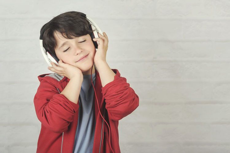 Child Boy Sing Accessory Headphones Music Audio Song Listen Hear Melody Sound Happy People Singer  Happiness Earphones Microphone Voice Performance Concert Karaoke Show Concept Portrait Emotion Record Joy Funny Fun Talent Star Expression Lifestyle Feeling Kid Leisure Activity Standing Childhood