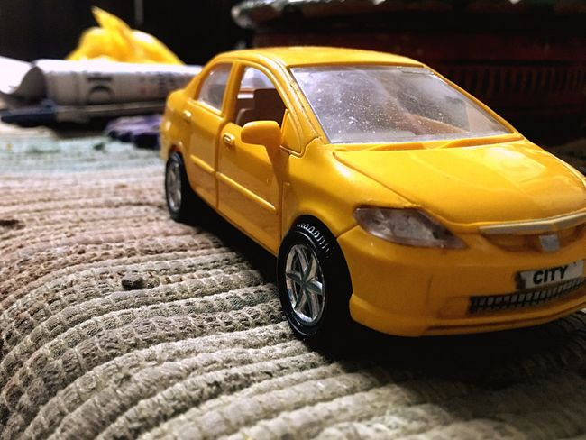 Paint The Town Yellow Yellow Taxi Transportation Car Yellow Taxi Land Vehicle No People Outdoors Toy Car Day Tire Close-up