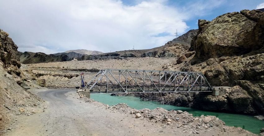 The Bridge across Rocks And Sand Adventures Of Ladakh Road Journey Metal Bridge Crossing Mountainous Terrain Alpine Landscape Long Journey Discovering Places Over The Indus Travel Photography The Great Outdoors - 2018 EyeEm Awards The Architect - 2018 EyeEm Awards The Traveler - 2018 EyeEm Awards