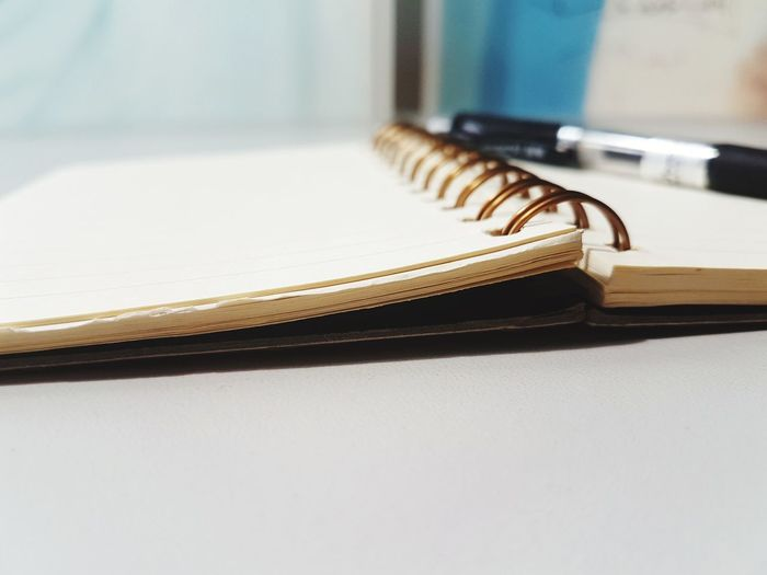 Close-up of spiral notebook on table